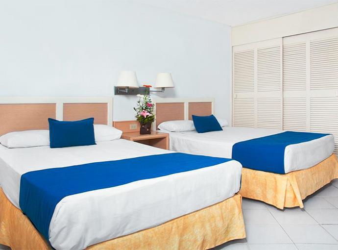 Habitaciones en el hotel calinda beach acapulco acapulco for Habitaciones conectadas hotel