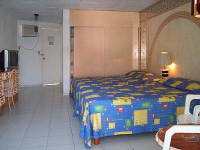 Habitaciones en el hotel el tropicano acapulco acapulco for Habitaciones conectadas hotel