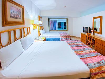 Habitaciones en el playa suites acapulco acapulco m xico for Hoteles playa con habitaciones familiares