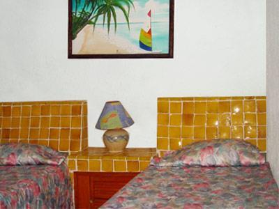 Hotel coral ixtapa ixtapa zihuatanejo for Recamaras con camas individuales